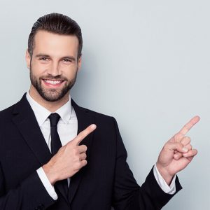 Portrait of satisfied stylish trendy fashionable cheerful excited confident expert with toothy beaming smile demonstrating copy empty blank space over the shoulder isolated gray background copyspace